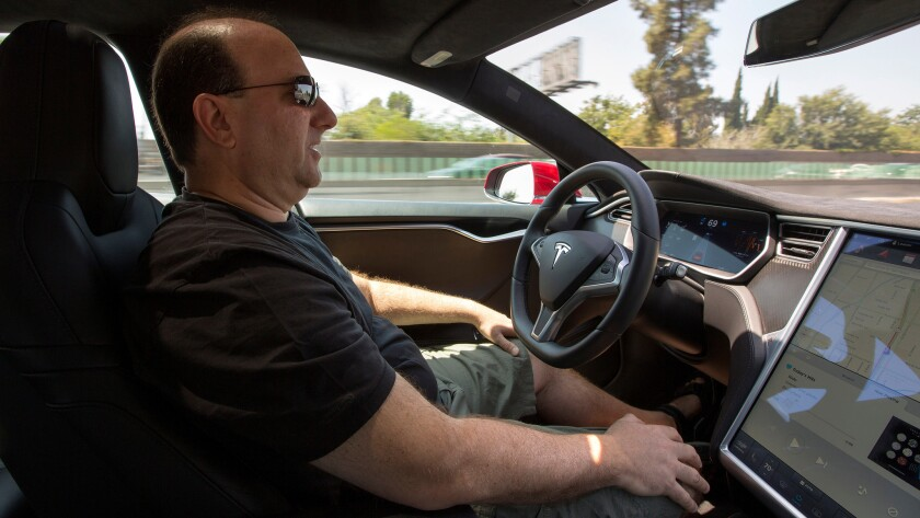 The president of the Los Angeles Tesla Club drives using autopilot on the 101 freeway near Sherman Oaks on July 1.