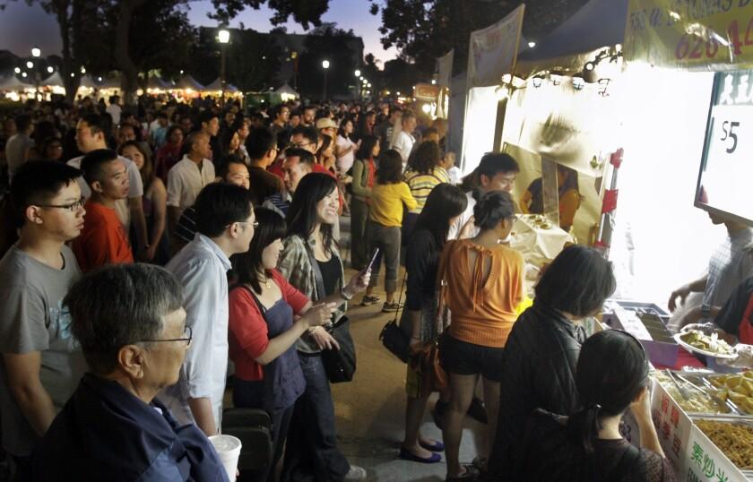 Food stalls draw crowds at the 626 Night Market in Pasadena.