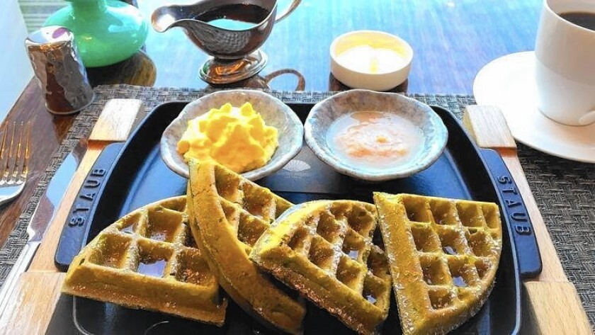 For weekend brunch, Mozen Bistro serves the Green Tea Waffle with lychee and passion fruit toppings.