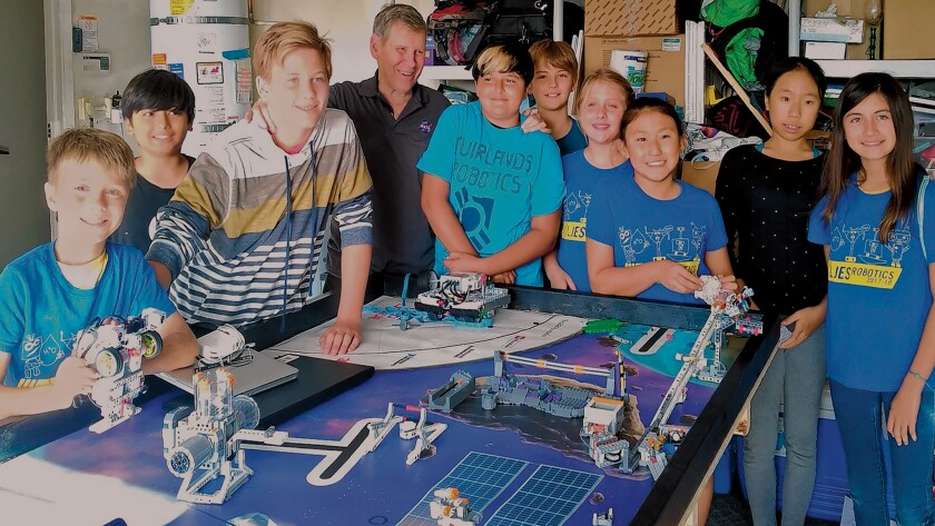 Astronaut Col. Sherwood 'Woody' Spring (center) meets with Muirlands Middle and La Jolla Elementary School robotics teams tackling FIRST LEGO League 'Into Orbit' Challenge associated with extended space travel.