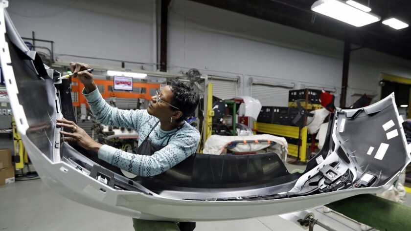 In this Nov. 28, 2018 photo, final inspector Mary Skinner inspects the rear end of a General Motors