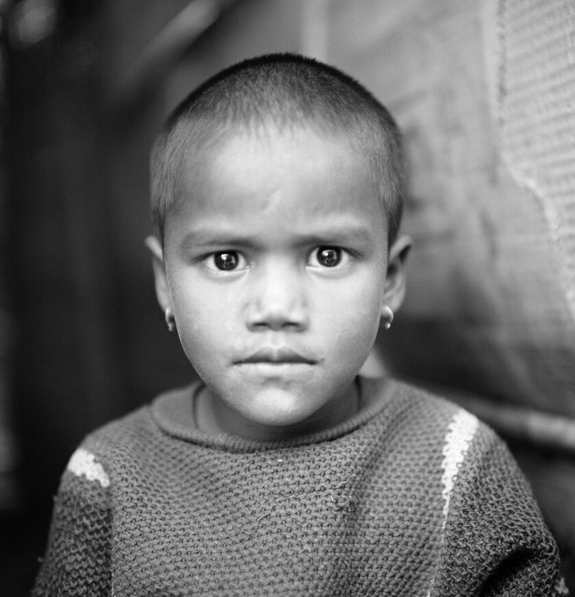 "A photograph featured in the book ""Human Archipelago."" Annu, Jai Hind squatter settlement, Delhi, In"