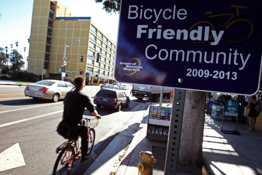 A cyclist rides past the Santa Monica Bike Center on Colorado Blvd. in Santa Monica.