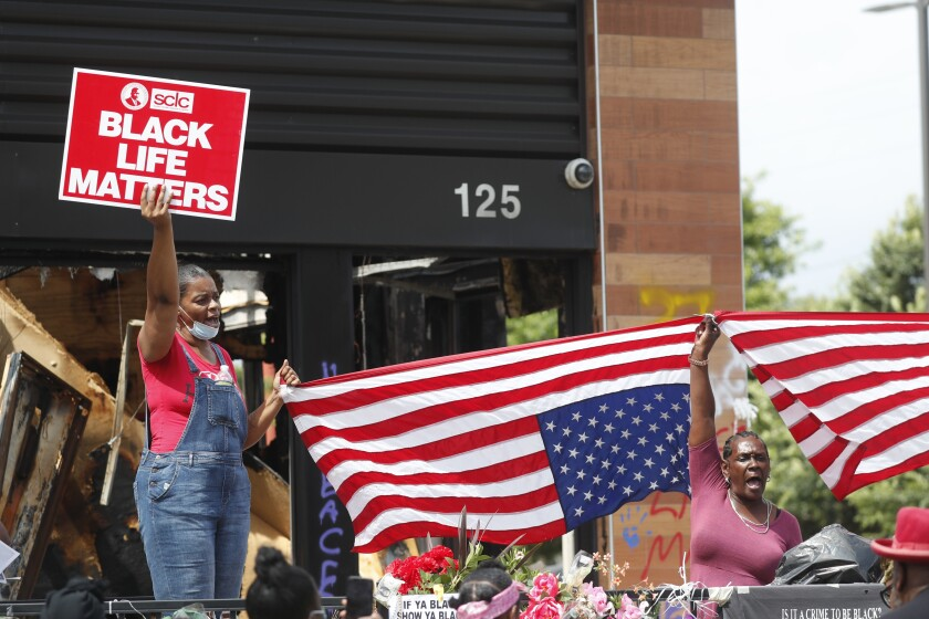 Protesters chant outside a Wendy's restaurant in Atlanta after Rayshard Brooks' funeral.
