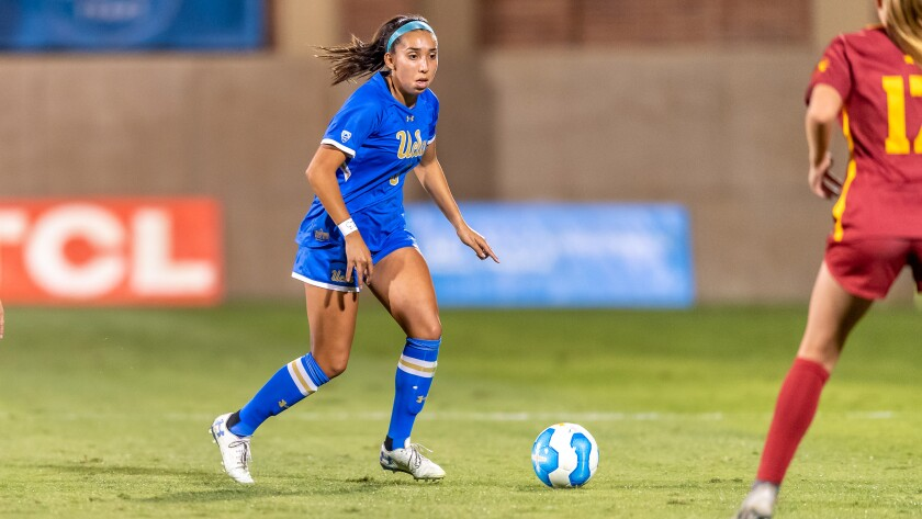 UCLA soccer player Karina Rodriguez controls the ball during a game.