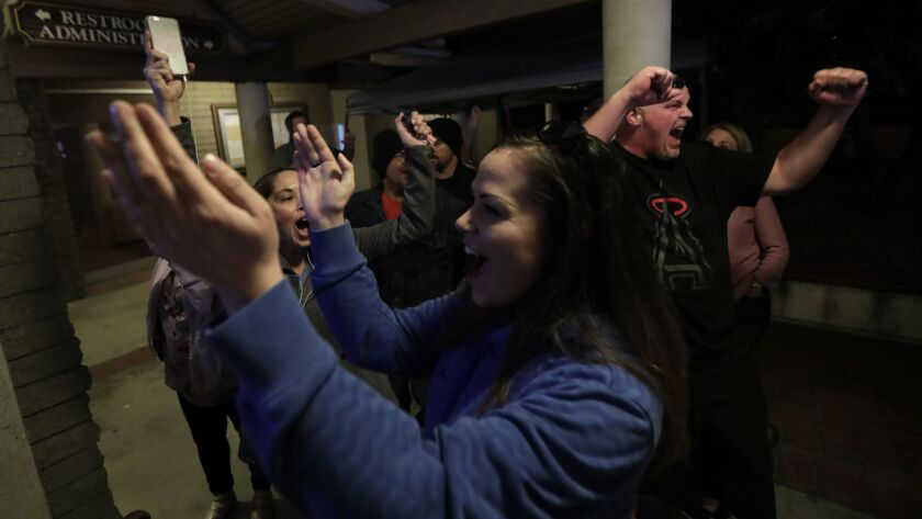 "Spectators cheer as the Los Alamitos City Council votes to oppose California's ""sanctuary state"" laws on March 19."