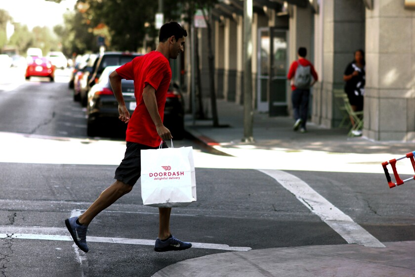 Delivery cap would apply to companies like DoorDash