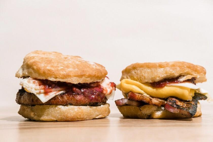 From left, an ADB biscuit breakfast sandwich with sausage and an ADB biscuit breakfast sandwich with bacon.