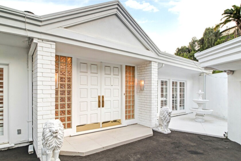 Built in the '60s, the single-story whitewashed Midcentury holds four bedrooms in about 3,400 square feet.