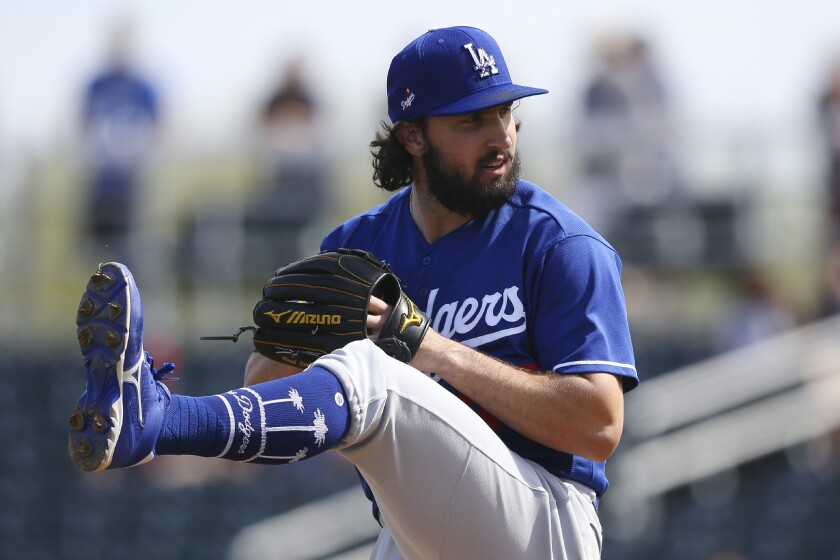 Dodgers pitcher Tony Gonsolin throws tossed 2 2/3 scoreless innings against the San Diego Padres on Monday.