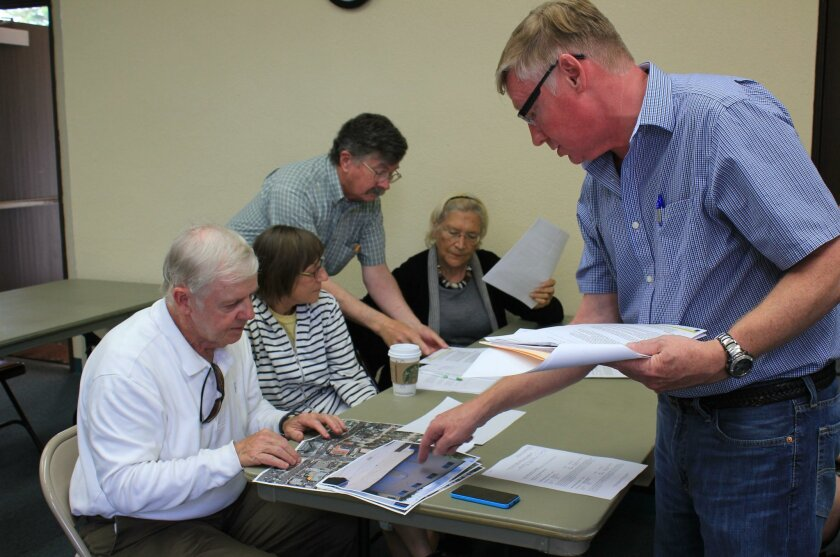 DPR committee members Jim Ragsdale, Diane Kane, Mike Costello, Angeles Liera and applicant Robert Bateman review condo conversion plans.
