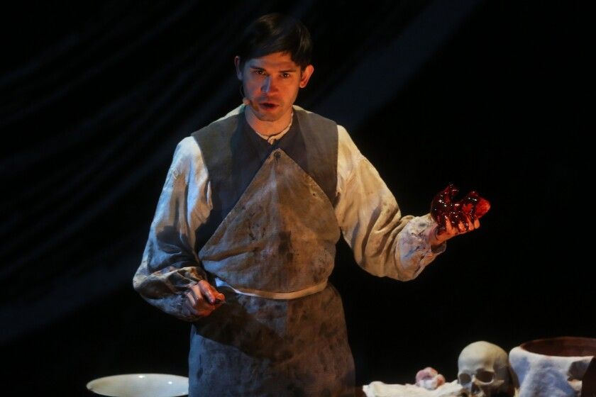 """One of Los Angeles' most distinctive singers, Timur, performs the role of Baron Peel's assistant in """"anatomy theater."""""""