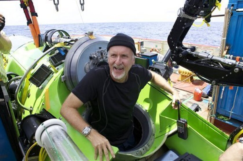 Filmmaker and National Geographic Explorer-in-Residence James Cameron emerges from the Deepsea Challenger submersible after his successful solo dive to the Mariana Trench, the deepest part of the ocean, Monday March 26, 2011. The dive was part of Deepsea Challenge, a joint scientific expedition by Cameron, the National Geographic Society and Rolex to conduct deep-ocean research. (AP Photo/Mark Theissen, National Geographic) ONE TIME USE