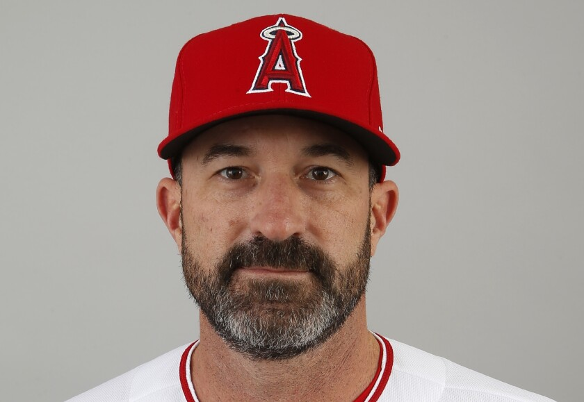 """FILE - This 2020 file photo shows Los Angeles Angels pitching coach Mickey Callaway. Callaway, former manager of the New York Mets and current Los Angeles Angels pitching coach, """"aggressively pursued"""" several women who work in sports media and sent three of them inappropriate photos, The Athletic reported Monday, Feb. 1, 2021. (AP Photo/Ross D. Franklin, File)"""
