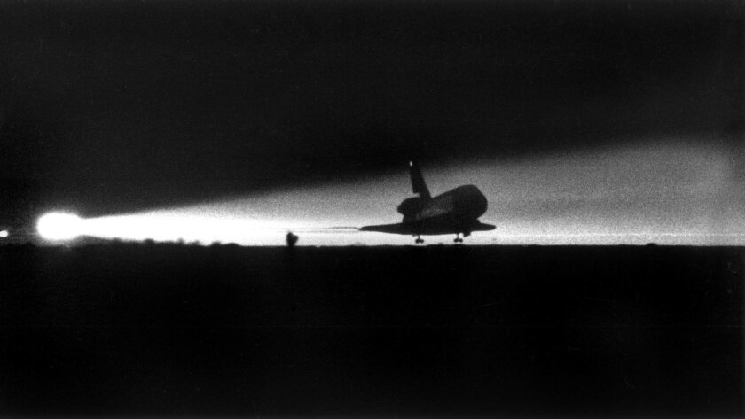 Jan. 18, 1986: A spotlight captures the landing of the shuttle Columbia at Edwards Air Force Base in the Mojave Desert.