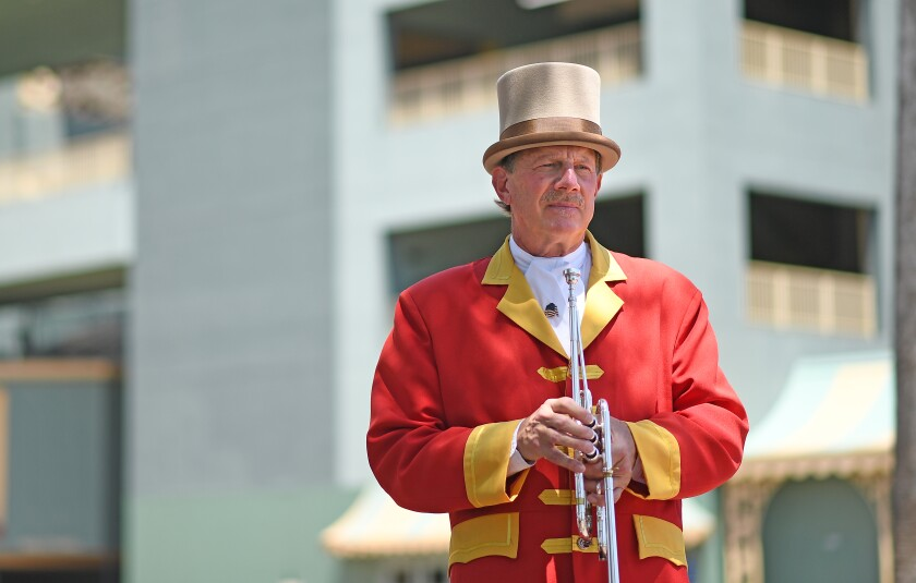Bugler Jay Cohen is one of the essential workers at the Santa Anita Park racetrack during the coronavirus pandemic.