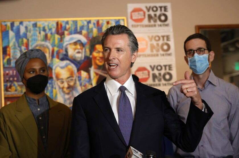Gov. Gavin Newsom speaks about the recall at a cafe in San Francisco in mid-August.