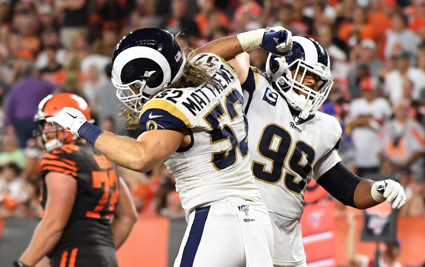 Rams linebacker Clay Matthews, left, celebrates with defensive tackle Aaron Donald after sacking Browns quarterback Baker Mayfield.