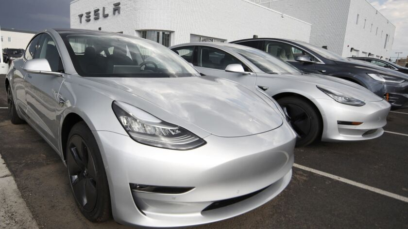 Model 3 sedans are displayed in a Tesla store lot in Colorado in 2018.