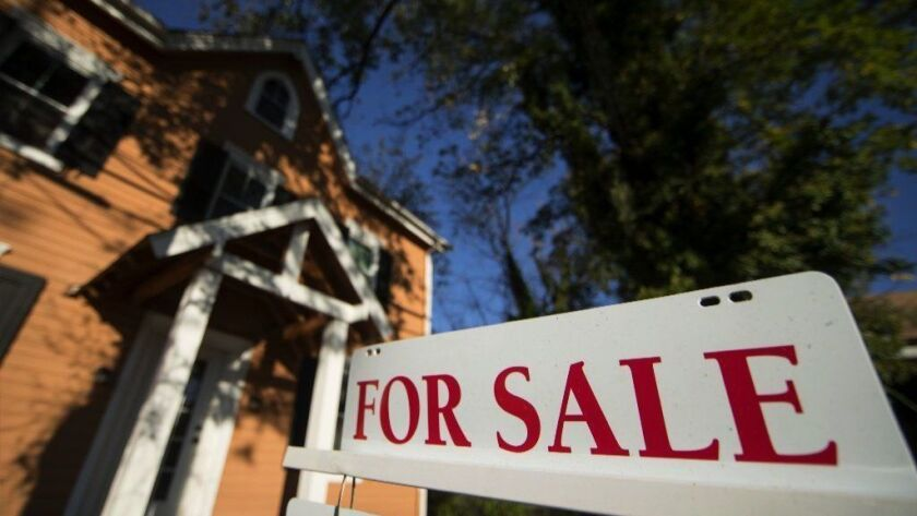 A home is advertised for sale in Fort Washington, Pa., in 2017. The National Association of Realtors said on Oct. 19, 2018, that homes sales declined 3.4 percent the previous month, the biggest drop in 2½ years.