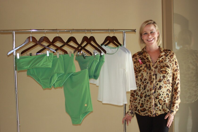 Dana Dinerman with the pieces of the Hulabelle swimwear line she designed to support women who have survived breast cancer