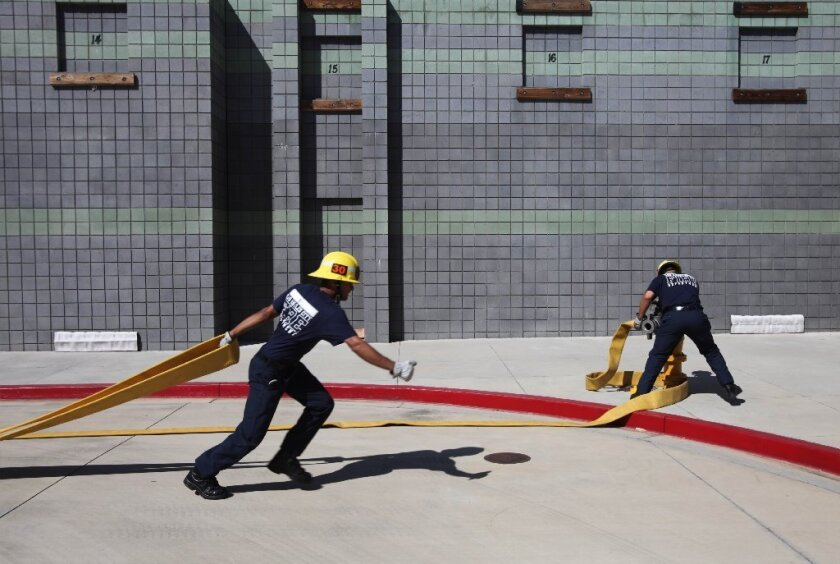Los Angeles Fire Department recruits participate in a training exercise in Panorama City.