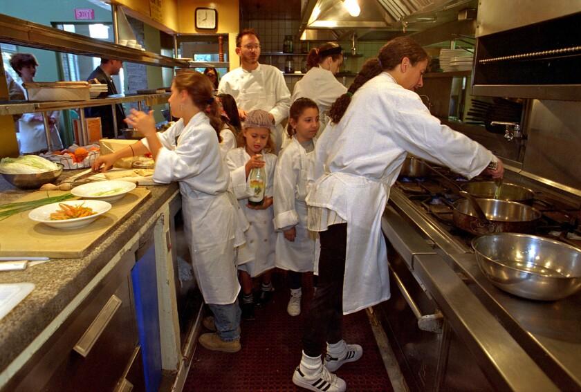Chefs cook in a restaurant kitchen