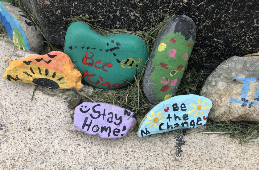 Painted rocks scattered across a Santa Clarita neighborhood offer hope and encouragement. The creators want to help people cope with coronavirus isolation.