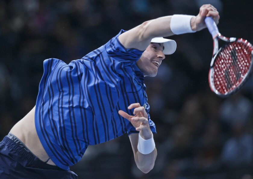 John Isner of the U.S. serves the ball to David Ferrer of Spain during their quarterfinal match of the BNP Masters tennis tournament at the Paris Bercy Arena, in Paris, France, Friday, Nov. 6, 2015. (AP Photo/Michel Euler)