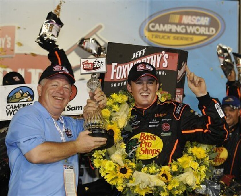 Ty Dillon, right, celebrates in victory lane after winning the NASCAR Camping World Truck Series auto race at Atlanta Motor Speedway, Friday, Aug. 31, 2012, in Hampton, Ga. (AP Photo/Rainier Ehrhardt)