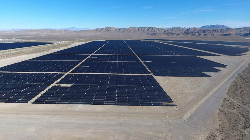 Solar arrays line the desert floor of the Dry Lake Solar Energy Zone as part of the 179-megawatt Switch Station 1 and Switch Station 2 Solar Projects north of Las Vegas that were commissioned on Dec. 11, 2017.