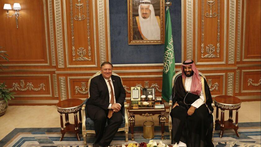 Secretary of State Mike Pompeo meets with the Saudi Crown Prince Mohammed bin Salman under a portrait of Saudi King Salman in Riyadh, Saudi Arabia on Oct. 16.