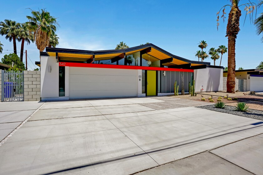 The Eichler-inspired floor plan holds four bedrooms and 2.5 bathrooms in 2,123 square feet.