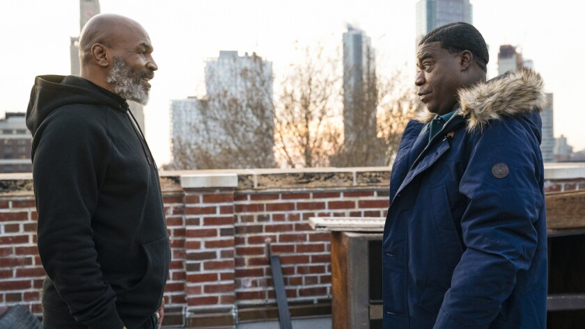 """Guest star Mike Tyson, left, and Tracy Morgan in the season premiere of """"The Last O.G."""" on TBS."""