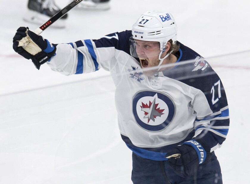 Winnipeg Jets' Nikolaj Ehlers celebrates his goal against the Toronto Maple Leafs during the third period of an NHL hockey game Thursday, April 15, 2021, in Toronto. (Frank Gunn/The Canadian Press via AP)