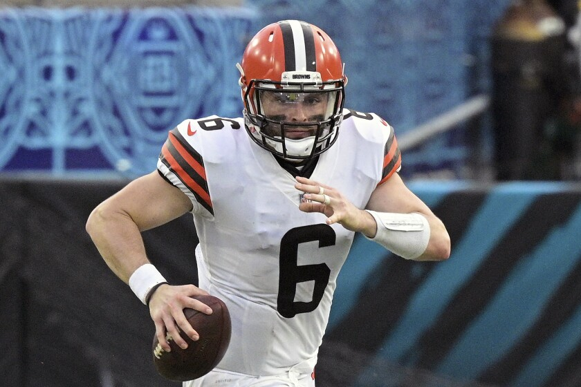 Cleveland Browns quarterback Baker Mayfield (6) scrambles for yardage during the second half of an NFL football game against the Jacksonville Jaguars, Sunday, Nov. 29, 2020, in Jacksonville, Fla. Mayfield made some head-scratching, jaw-dropping mistakes Sunday in Jacksonville, turning what should have been a fairly routine win for the Browns into a nail-biter. But despite his errors, Mayfield didn't commit a quarterback's biggest sin _ an interception. (AP Photo/Phelan M. Ebenhack)