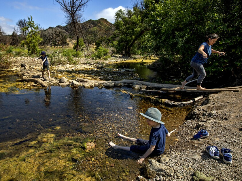 Declan Beck, left, his brother Colson and friend Dayna Monbello visit Malibu Creek State Park near Calabasas.