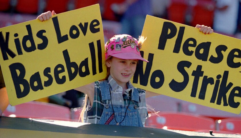 Erin States, 10, of Tracy, Calif., holds up a sign at an Oakland A's game on Aug. 11, 1994, urging major leaguers not to strike.