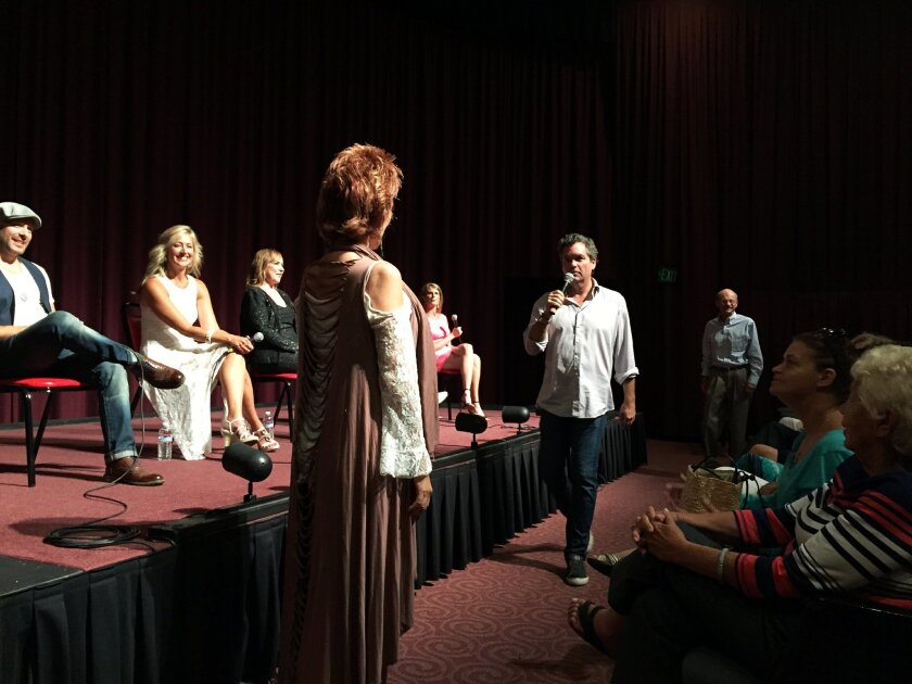 """Great Love Debate"" founder and moderator Brian Howie, center, creates a date scenario between audience members ""Joy,"" left, and ""Ken,"" far right, while a panel of dating experts look on Thursday at the Carlsbad Village Theatre. CREDIT: Pam Kragen/U-T"