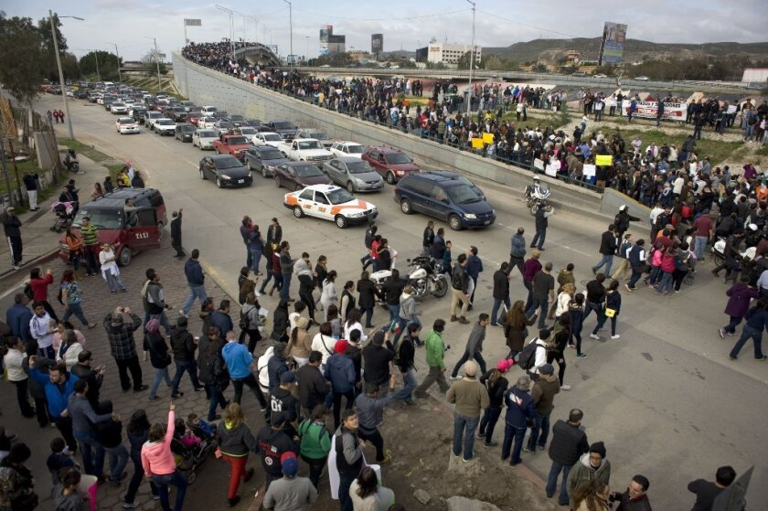 Thousands of people blocked traffic while protesting Mexico's recent gasoline price increases at Tijuana's El Chaparral port of entry last weekend.