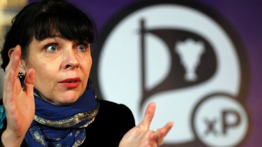 Birgitta Jonsdottir of the Pirate Party addresses reporters during a news conference in Reykjavik, Iceland, on Sunday.