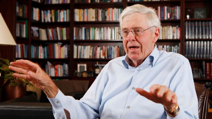 FILE - In this May 22, 2012 file photo, Charles Koch speaks in his office at Koch Industries in Wich