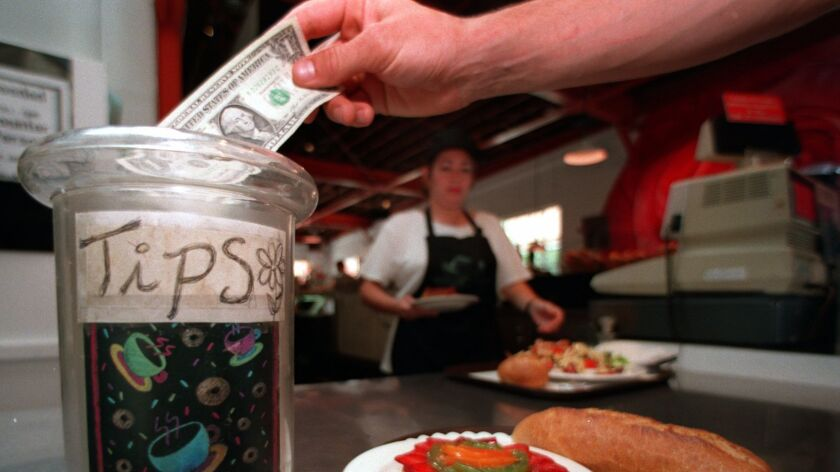 """Tips go up two percentage points if a server writes """"Thank You"""" on the back of a patron's check, research found."""