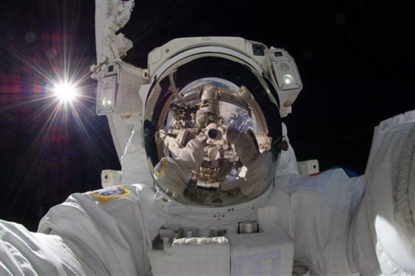 NASA astronauts take selfies, too.