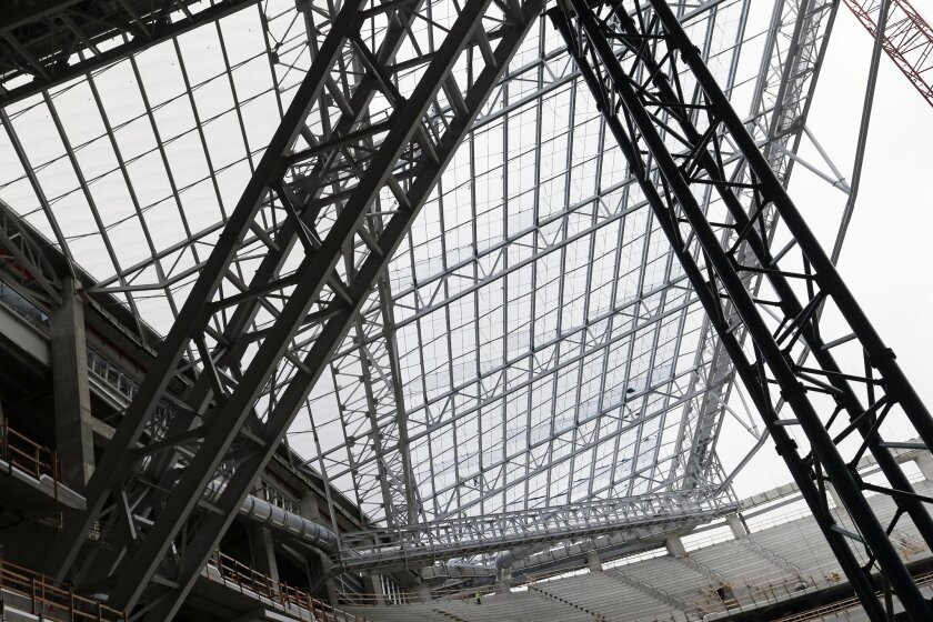 In this photo taken Thursday, July 16, 2015, installed see-through, lightweight EFTE roof panels are visible, upper left triangular section, as the roof takes shape at the new Minnesota Vikings NFL football stadium that is under construction in Minneapolis. The architect chose the alternative roof