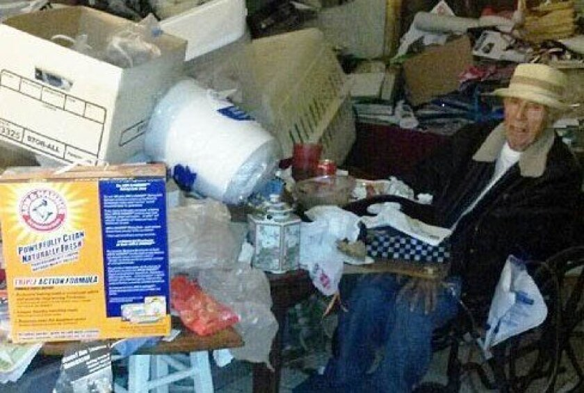 Robert Stella amidst deplorable living conditions before he was removed from his home and separated from his estranged wife.