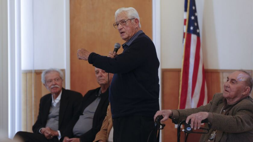 Speaking at a panel about the history of tuna fishing in San Diego, Julius Zolezzi demonstrated for the audience how they used poles to fish for tuna. Zolezzi was among the guests invited to discuss the Portuguese perspective on San Diego's fishing history.