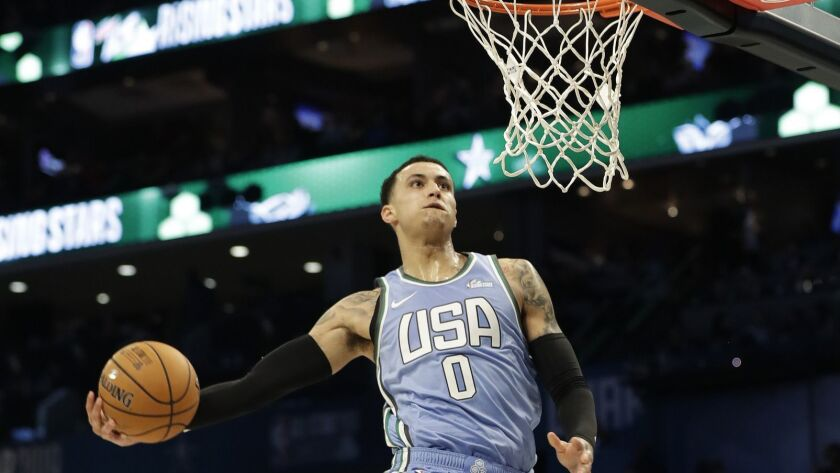 U.S. Team's Kyle Kuzma, of the Los Angeles Lakers heads to the hoop for a dunk against the World Tea