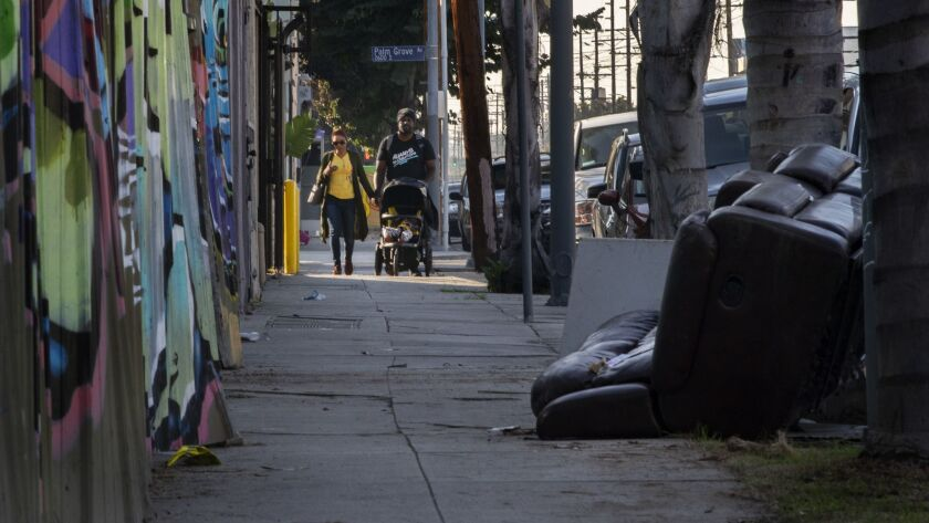 LOS ANGELES, CA - DECEMBER 11, 2018: An overturned couch lays near the sidewalk in front of Union Ge