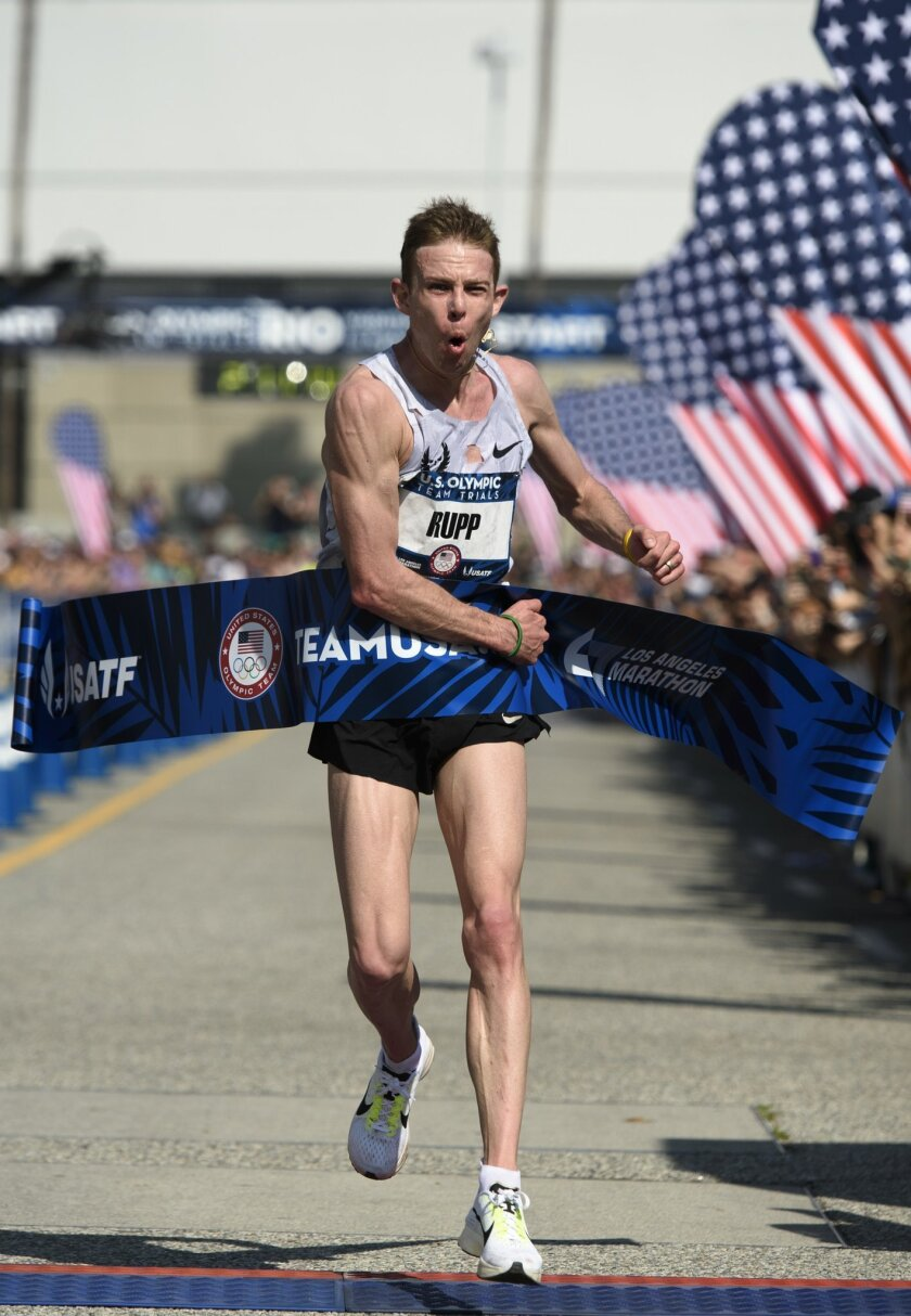 Galen Rupp reacts after crossing the finish line to win U.S. Olympic Team Marathon Trials, Saturday, Feb. 13, 2016, in Los Angeles. The 29-year-old Rupp completed his marathon debut in 2 hours, 11 minutes, 10 seconds, earning a berth to the Rio Games. (AP Photo/Kelvin Kuo)